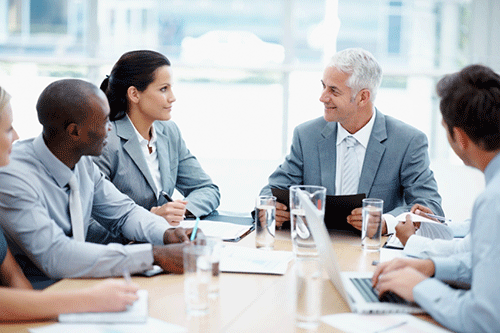 business communication business associates sitting at conference table